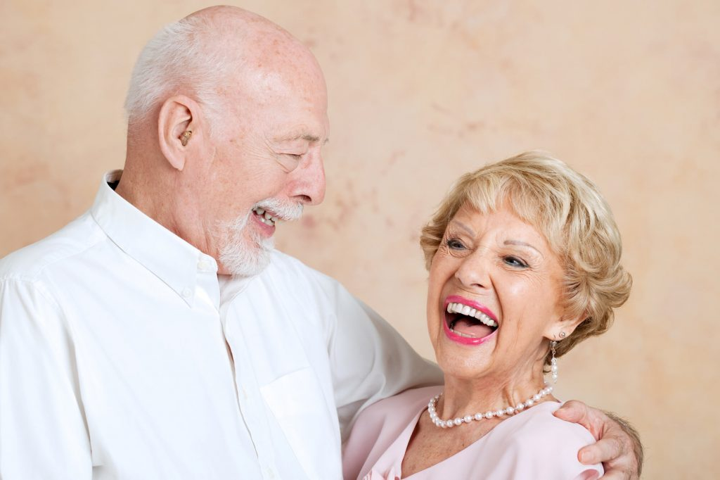 happy senior couple with dentures implant support in West Palm Beach