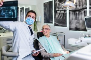 woman dentures implant support west palm beach