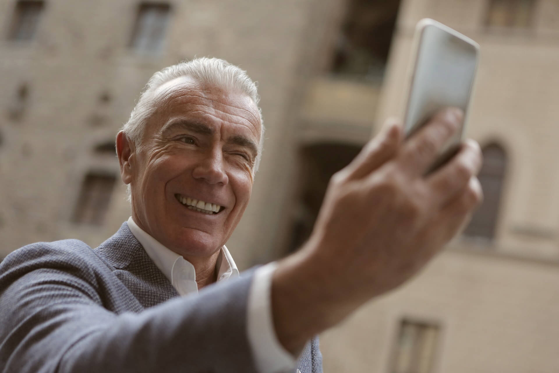 smiling man with dentures implant support in West Palm Beach
